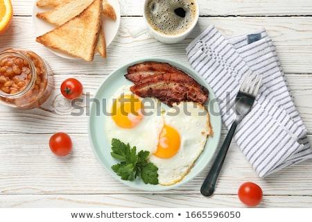 Sahanda yumurta domuz pastırması fasulye meyve yumurta arka plan Stok fotoğraf © M-studio