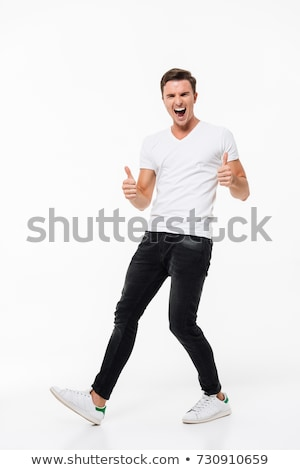 full length portrait a satisfied young man stock photo © deandrobot