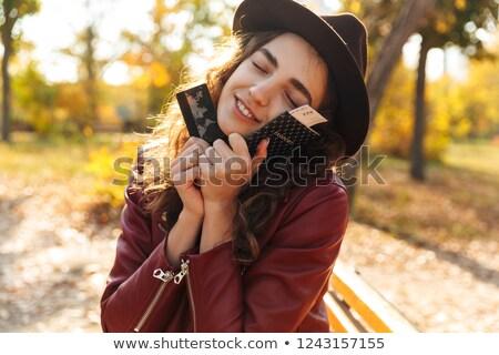 Cute mujer sesión banco parque Foto stock © deandrobot