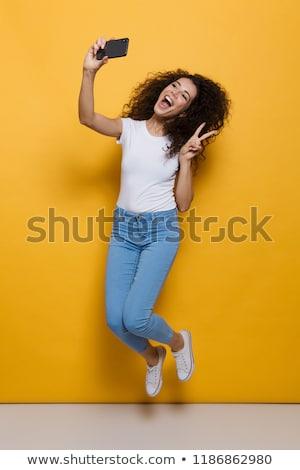 Foto Brünette Frau 20s lockiges Haar Stock foto © deandrobot