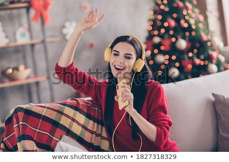 Kép bájos nő visel fülhallgató szórakozás Stock fotó © deandrobot