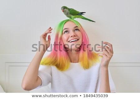 улыбающаяся женщина красочный Parrot красивой тропические Сток-фото © NeonShot
