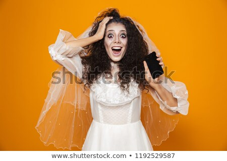 Surpreendido noiva zumbi mulher olhando câmera Foto stock © deandrobot