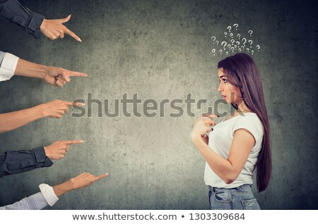Anxious surprised woman being judged by different people pointing fingers at her. Stock photo © ichiosea