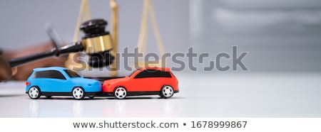 Green And Red Car In Front Of Gavel And Mallet Stock photo © AndreyPopov