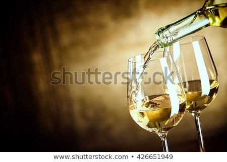 Bottiglia di vino bianco occhiali muro di pietra spazio vino muro Foto d'archivio © karandaev