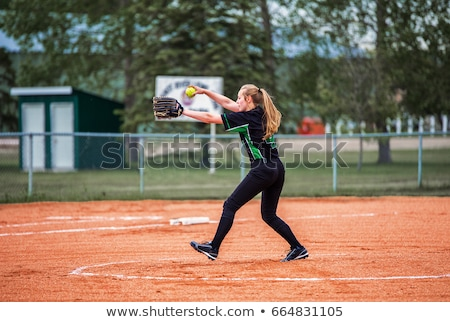 Girl playing baseball about to pitch Stock photo © colematt
