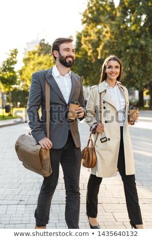 Full length photo of caucasian office man in formal wear holding Stock photo © deandrobot