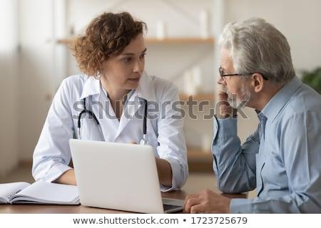 doctor or nurse explaining prescription medicine to senior adult stock photo © feverpitch