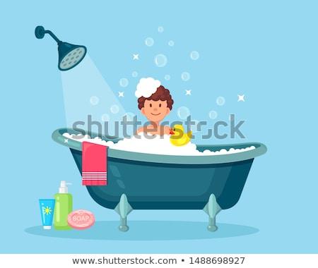 Homem relaxante banheira borracha pato Foto stock © nito