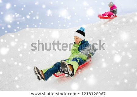 Zdjęcia stock: śniegu · spodek · zimą · dzieciństwo · saneczkarstwo
