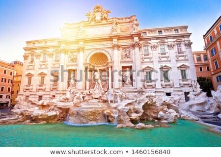 Majestic Trevi fountain in Rome sun haze view Stock photo © xbrchx