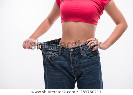 Concept of dieting with oversized jeans Stock photo © Elnur