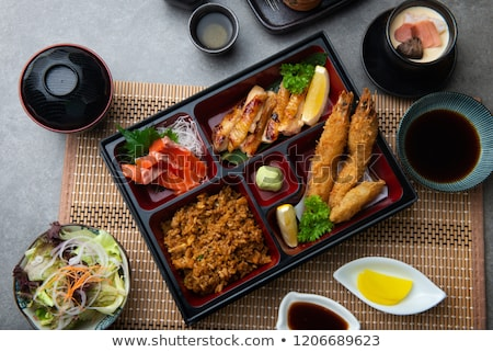 Bento set of prawn tempura and chicken teriyaki in japanese restaurant Stock photo © galitskaya