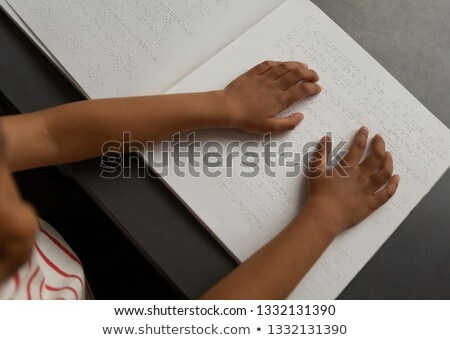 High angle view of mixed-race blind schoolboy hands reading a braille book in classroom at elementar Stock photo © wavebreak_media