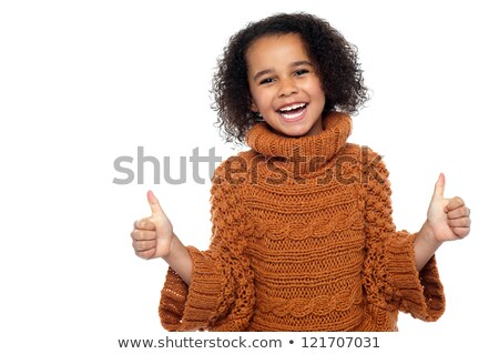 Cute kid showing double thumbs up to camera stock photo © stockyimages