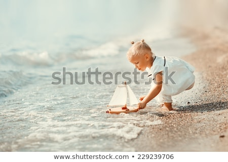funny small toy sailing ships on the beach stock photo © tannjuska