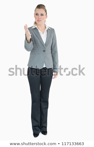 Businesswoman being angry while pointing at the front Stock photo © wavebreak_media