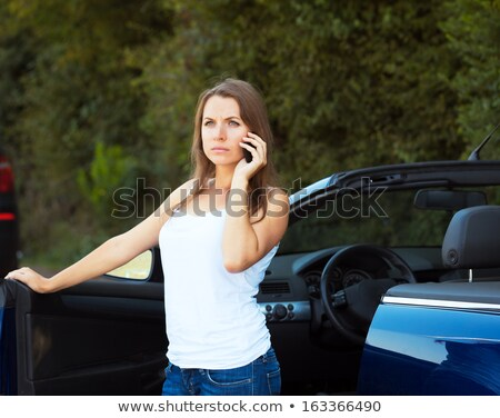 Caucasian girl on a cell phone service or tow truck traffic near Stock photo © vlad_star