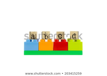 abcd word on wood stamps and colorful toy blocks Stock photo © vinnstock