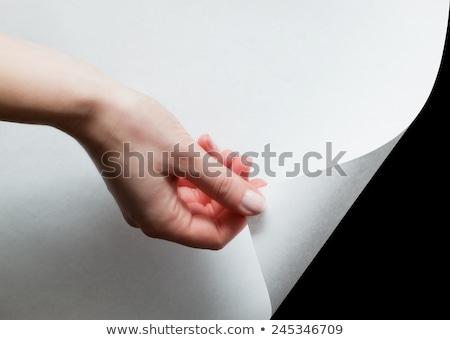 Mão borda papel algo página Foto stock © photocreo