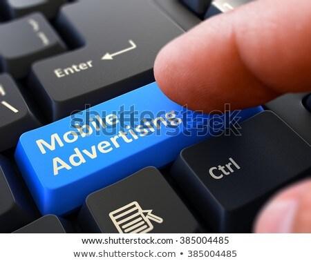 ストックフォト: 指 · 青 · キーボード · ボタン · 携帯 · 広告