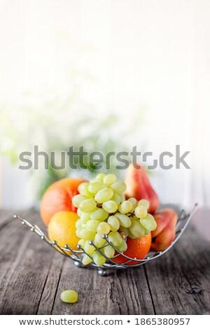 Juicy grapes in wicker basket at organic section Stock photo © wavebreak_media