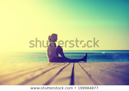 Sunny morning on the beach, athletic woman resting after running Stock photo © vlad_star