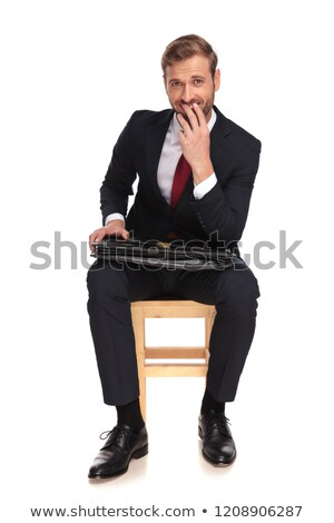 joyful businessman laughing and thinking while waiting for inter stock photo © feedough