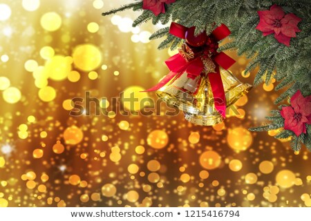 beautiful golden sparkles with christmas bells background Stock photo © SArts