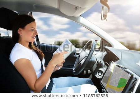 Woman Sitting Inside Self Driving Car Stock photo © AndreyPopov