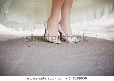 beautiful bride's feet in shoes and white dress stock photo © ruslanshramko