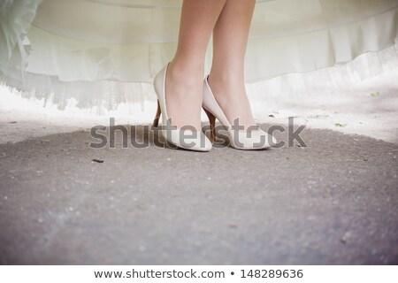 beautiful bride's feet in shoes and white dress Stock photo © ruslanshramko