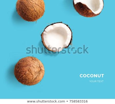 Stockfoto: Fresh Coconut on blue background. Flat lay.