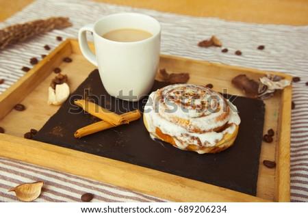 Coffee and cinnamon rolls Stok fotoğraf © karandaev
