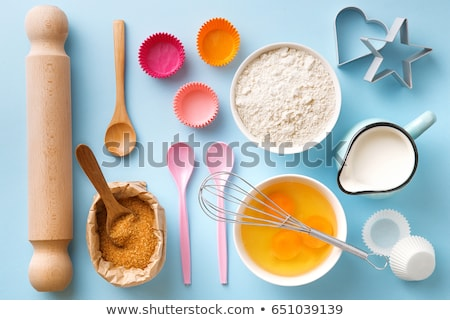 Eggs, wooden spoon and whisker.  Stock photo © marylooo