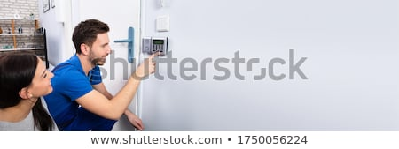 Handyman Installing Security System Near Door Wall Stock photo © AndreyPopov