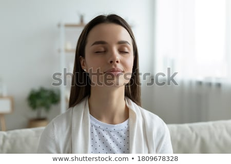 穏やかな 優しい 若い女性 瞑想 ホーム 座って ストックフォト © Giulio_Fornasar