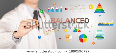 Nutritionist giving you a pill  Stock photo © ra2studio