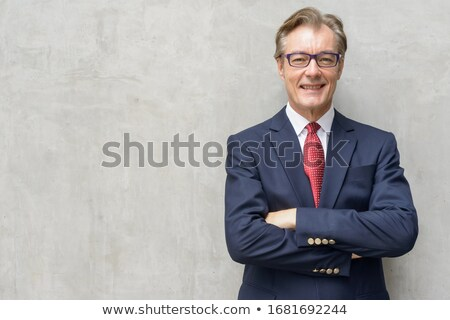 Confident grey-haired businessman Stock photo © photography33
