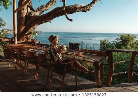 jonge · vrouw · met · behulp · van · laptop · mobiele · telefoon · vergadering · vloer · business - stockfoto © photography33