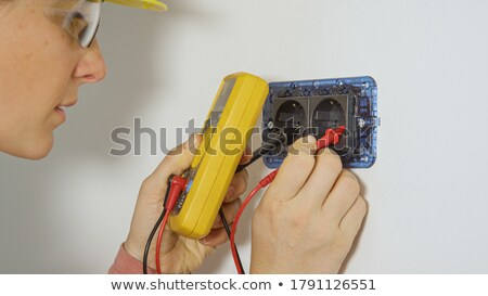 Female electrician checking socket Stock photo © photography33