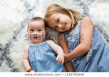 adorable baby playing with white blanket stock photo © jirkaejc