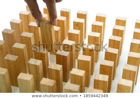 Young man with a row of dominoes Stock photo © photography33