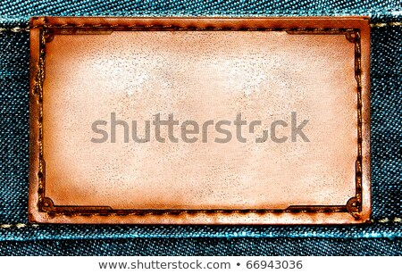 brown jeans label over blue jeans stock photo © inxti