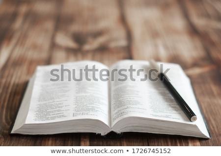 open book with loupe closeup Stock photo © mizar_21984