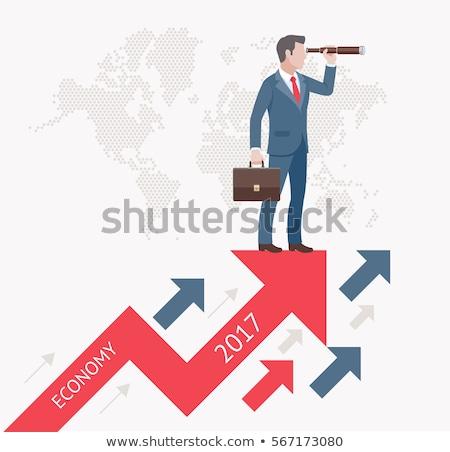 business man looks through binoculars stock photo © feedough