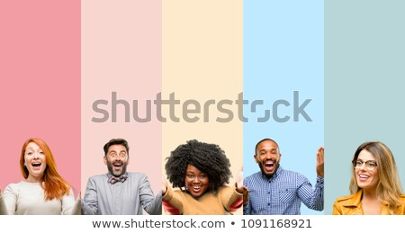 happy group of casual people welcoming and inviting Stock photo © feedough