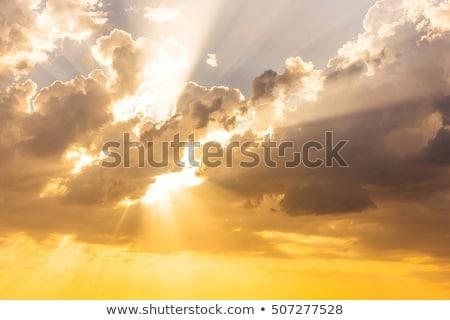 Sunny sky with dark clouds Stock photo © BSANI