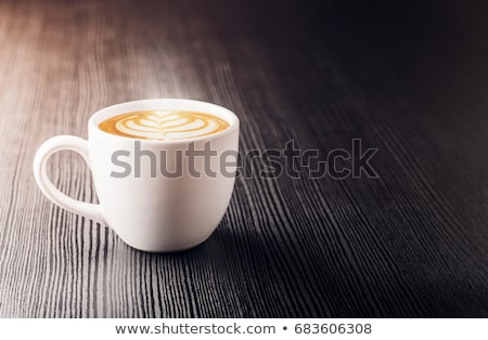 White cup of coffee and on a glass table Stock photo © CaptureLight